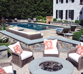 Outdoor Fireplace & Stone Walls Surrounding Pool